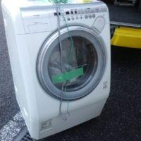 ドラム式洗濯機を吊り下げ回収